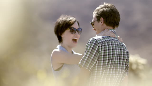 young couple in love dance in desert cactus grove - cute cactus stock videos & royalty-free footage
