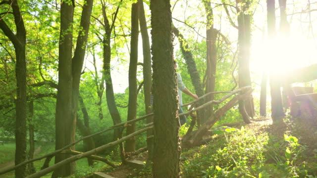 vídeos de stock e filmes b-roll de young couple in love enjoying in spring day in the forest. - subir