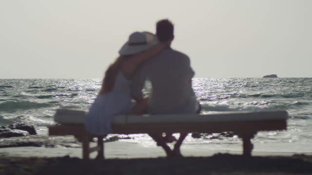 young couple in love enjoying time together on a beach - multiple shots available - outdoor chair stock videos & royalty-free footage