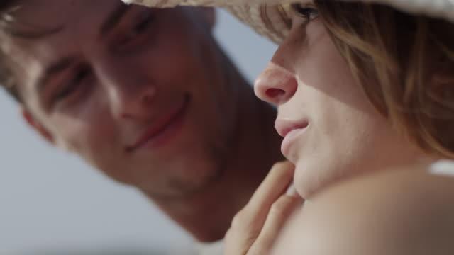 vídeos de stock, filmes e b-roll de young couple in love enjoying time together on a beach - multiple shots available - amor à primeira vista