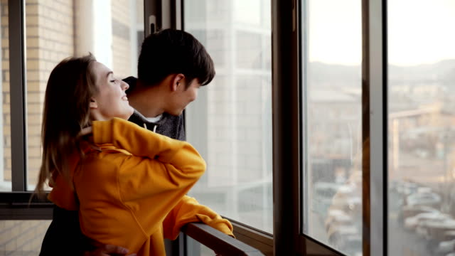 young couple in love - balcony stock videos & royalty-free footage