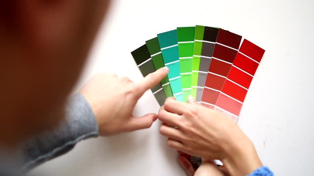 young couple in new home selecting wall colour - color swatch stock videos & royalty-free footage