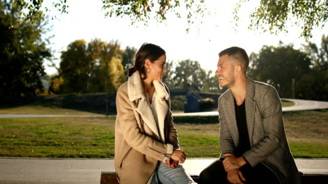 young couple in park in autumn.joke and laughter - actor stock videos & royalty-free footage