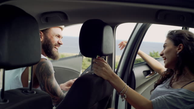 young couple in the car - sitting stock videos & royalty-free footage