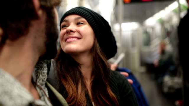 Young Couple in the Subway Train in NYC