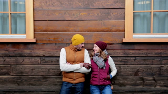 young couple in winter clothing - log cabin stock videos & royalty-free footage