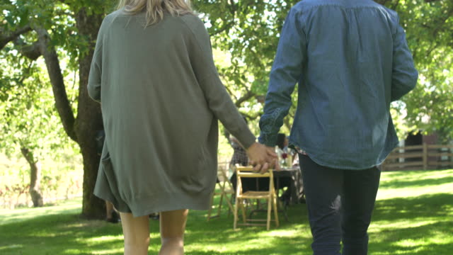 young couple joining a group of people for an outdoor party - 35 39 years stock videos & royalty-free footage