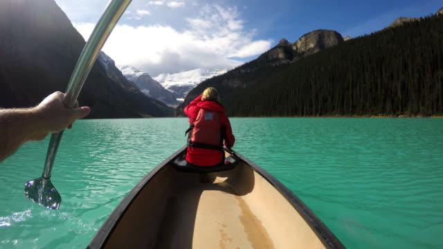 Young couple Kayaking on Lake Louise Alberta Canada