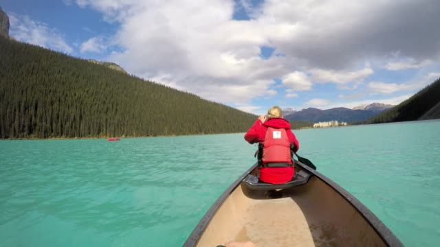 Young couple Kayaking on Lake Louise Alberta Canada