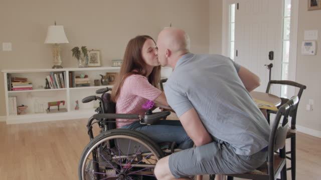 vídeos de stock e filmes b-roll de young couple kiss after celebratory toast - paralisia