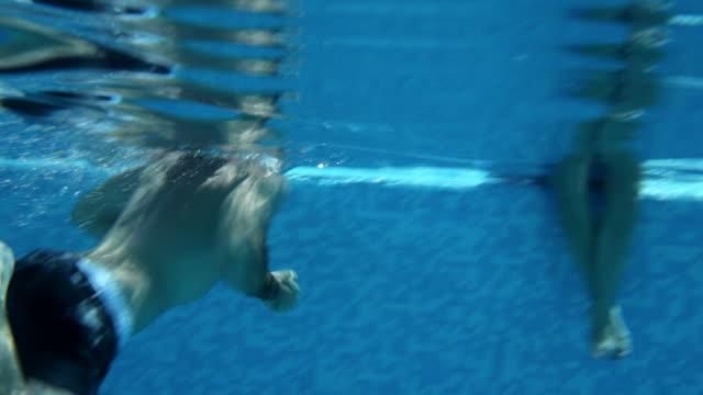 ms young couple kiss in infinity pool,mallorca - インフィニティプール点の映像素材/bロール
