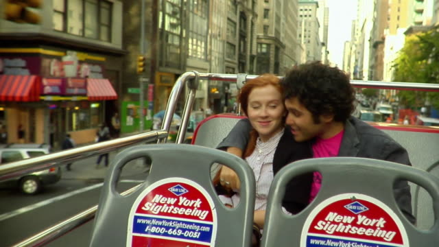 ms young couple kissing and taking pictures as they ride on the top level of a double decker bus/ new york city - sideburn stock videos & royalty-free footage