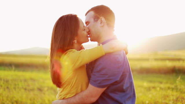 Young couple kissing in sunset