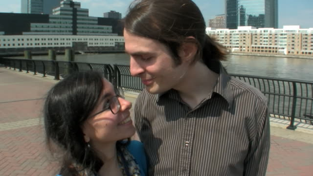ms young couple kissing on jersey pier / jersey city, new jersey, usa - falling in love stock videos and b-roll footage