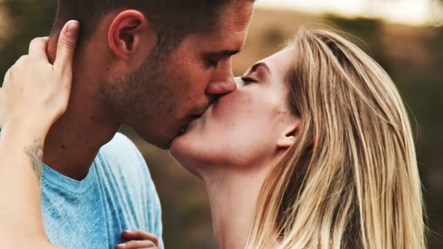 young couple kissing while hiking - heterosexual couple stock videos & royalty-free footage