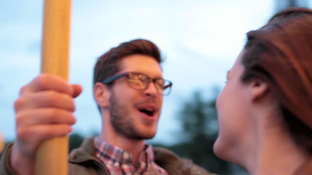 vidéos et rushes de cu. young couple laugh and cheer as they go around on eiffel tower carousel. - d'ascendance européenne