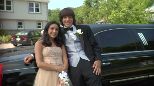 ms, young couple leaning at limo, portrait, edison, new jersey, usa - boutonniere stock videos and b-roll footage