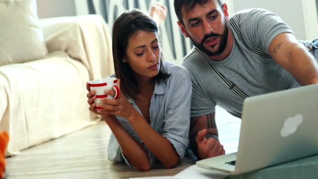 young couple looking at decoration brochures. - choosing stock videos and b-roll footage