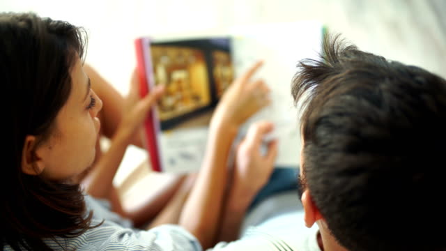 young couple looking at decoration brochures. - brochure stock videos & royalty-free footage