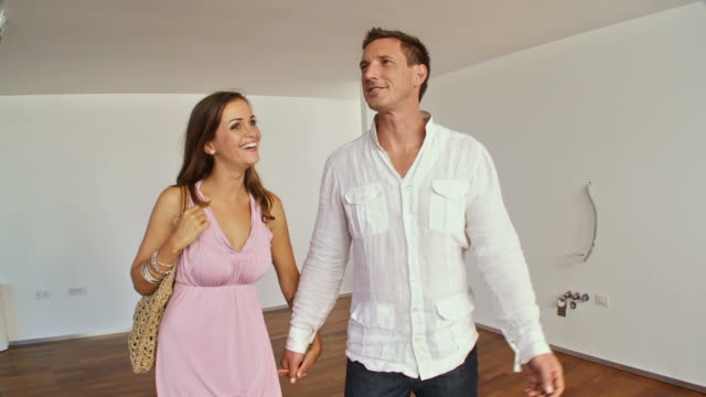 hd steadycam: young couple looking for a new home - open house stock videos & royalty-free footage