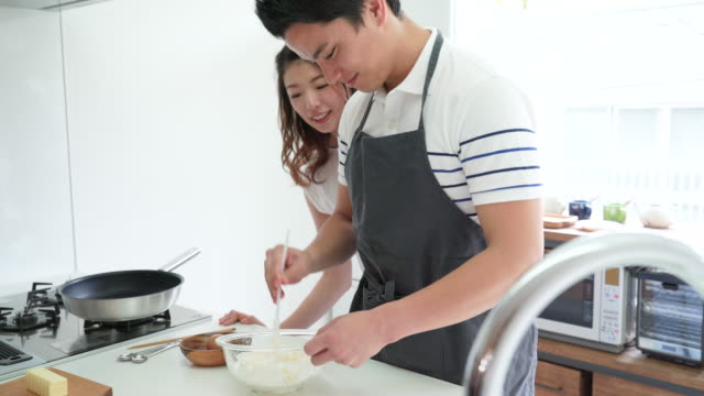 Young couple making sweets together