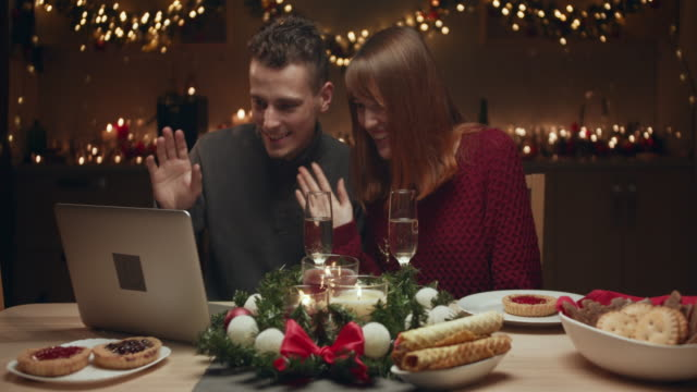 young couple meets christmas online. they communicate with relatives via the internet. - calendar date stock videos & royalty-free footage