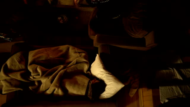 hd: young couple near the fireplace in a chalet - blanket stock videos and b-roll footage
