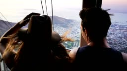 Young couple of tourists on Overhead Cable car ride above downtown Cape town HD Video