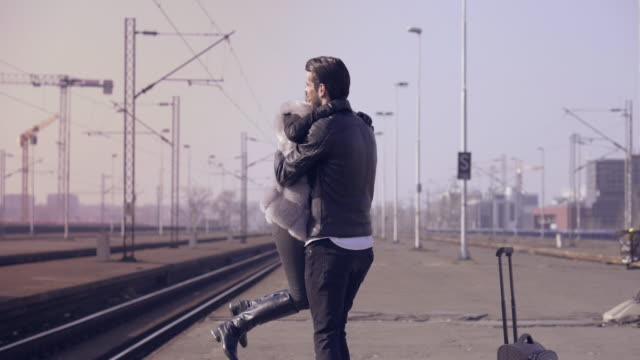 Young couple on a railroad station