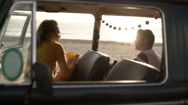 ms young couple on a road trip in their camper van - furgone video stock e b–roll