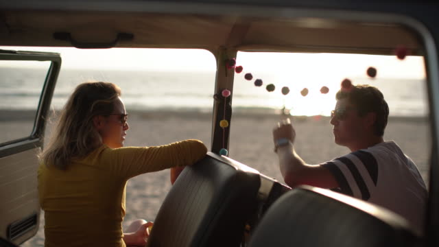 ms young couple on a road trip in their camper van - lieferwagen stock-videos und b-roll-filmmaterial