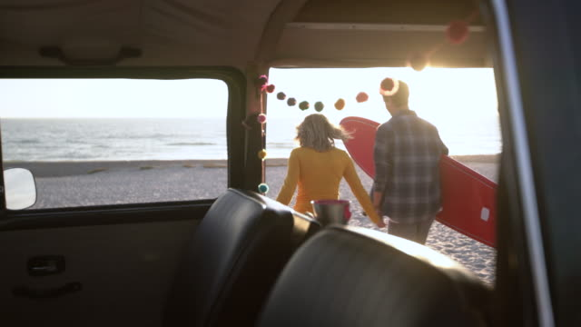rv ws young couple on a road trip in their camper van - van stock videos & royalty-free footage