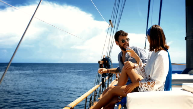 young couple on a sailing cruise. - yachting stock videos & royalty-free footage