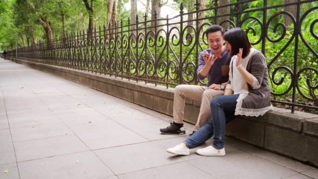 young couple on a sidewalk in taipei taiwan - conference phone stock videos & royalty-free footage