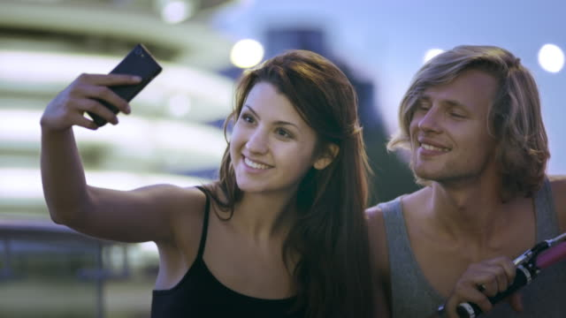 Young couple on bicycles. Selfie