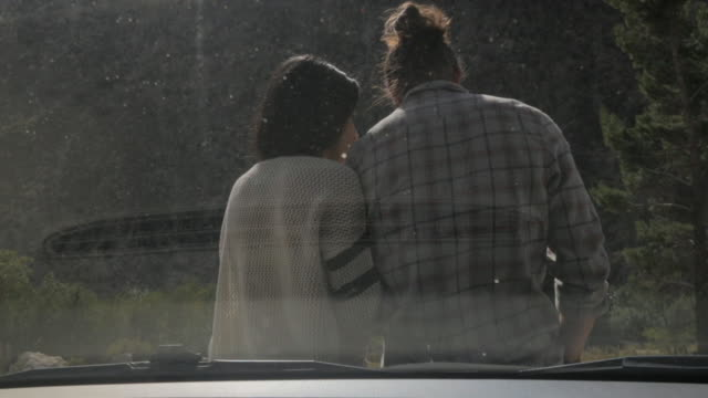Young Couple on Car Hood
