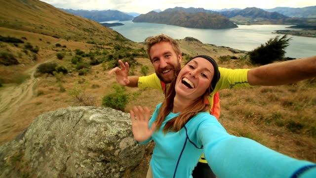 young couple on mountain take a self portrait - oceania stock videos and b-roll footage