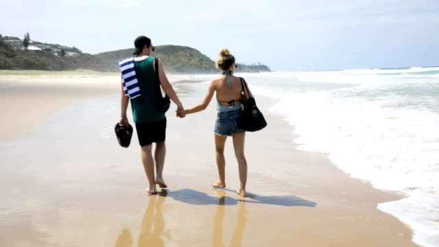 Young Couple on Sunrise Beach