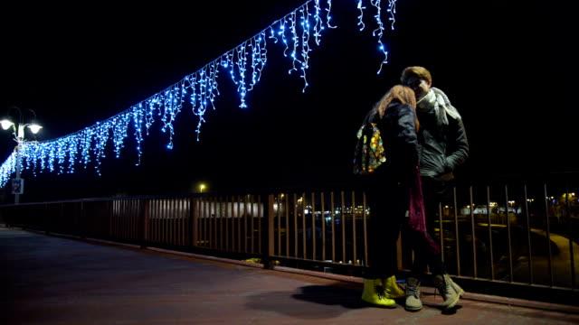 Young couple on the bridge