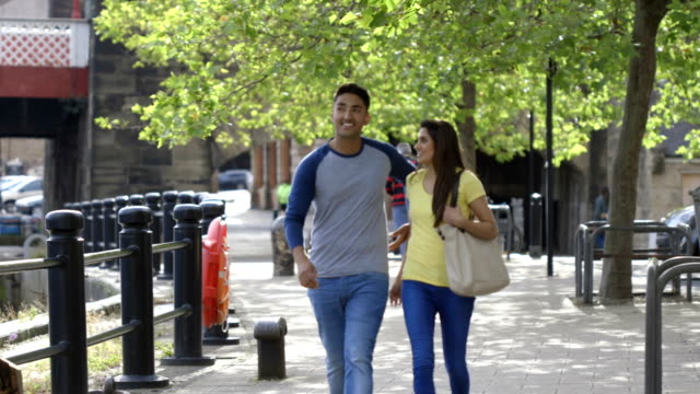 young couple out walking - teenage couple stock videos & royalty-free footage