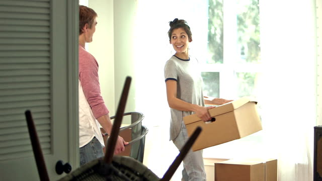 Young couple packing up and moving out of house