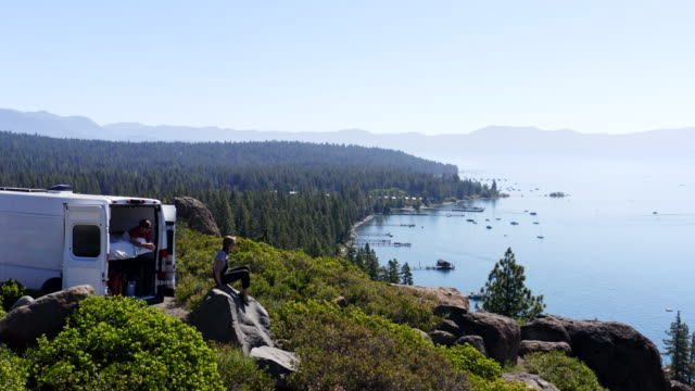 young couple parked van at a viewpoint of lake tahoe - van stock videos & royalty-free footage