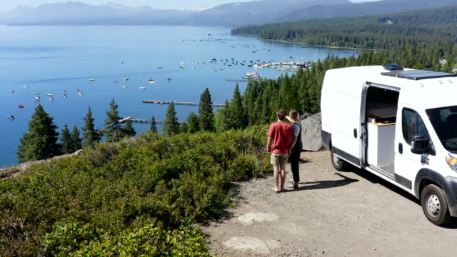 young couple parked van at a viewpoint of lake tahoe - mode of transport stock videos & royalty-free footage