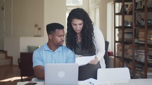 young couple paying bills online - budget stock videos & royalty-free footage