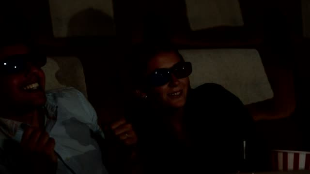 young couple people watching 3d movie in cinema with happiness - 3d glasses stock videos & royalty-free footage