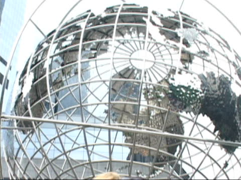 ms, td, young couple photographing self in front of globe sculpture at columbus circle, new york city, new york, usa - columbus circle stock videos & royalty-free footage