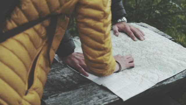 young couple planning their trip with map. close up - map stock videos & royalty-free footage