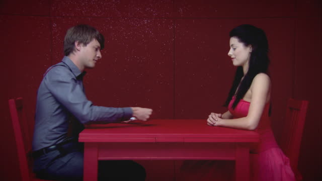 young couple play cards - shuffling stock videos and b-roll footage