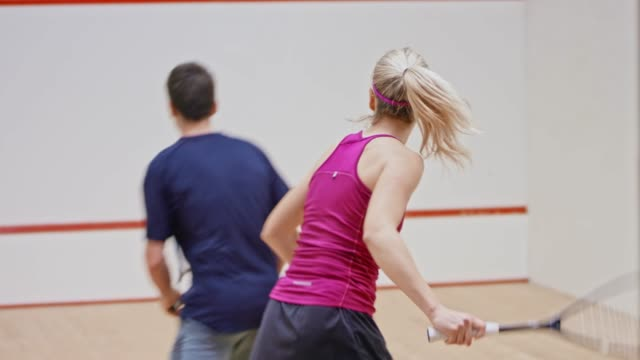 young couple playing squash - squash sport stock videos & royalty-free footage