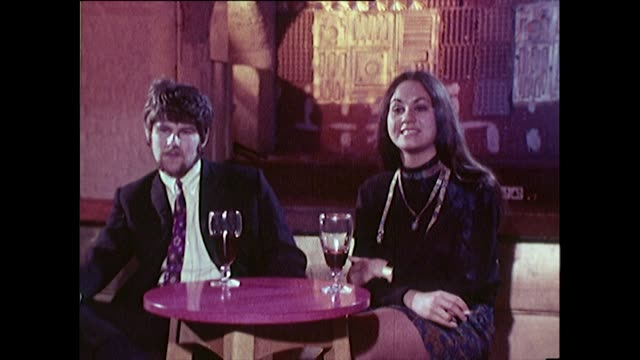 a young couple recall their experience of the cavern club - wine glass stock videos & royalty-free footage